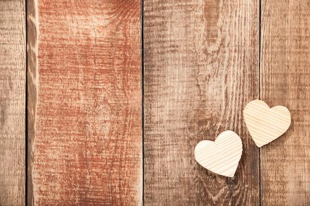 Valentine's hearts  on wooden background