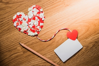 Valentine's paper heart with a blank business card