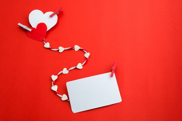Valentine's paper hearts with a blank business card