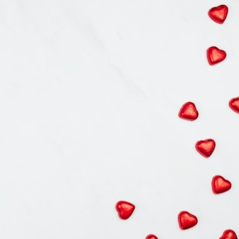 Valentine's red chocolate hearts on a white background