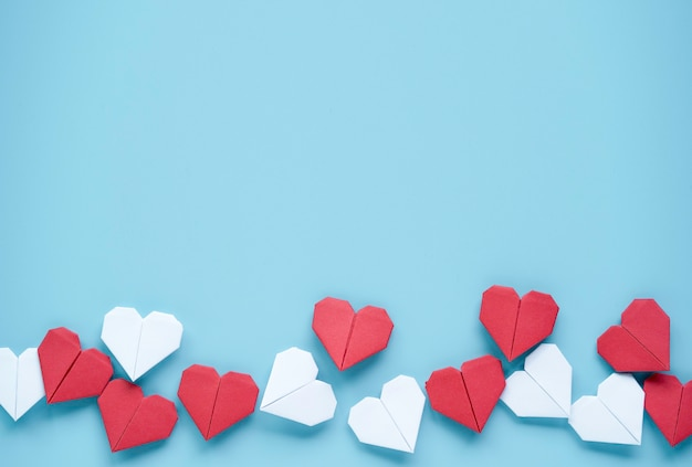 Valentine's day concept, red and white heart on blue background.
