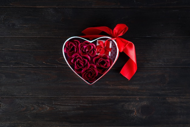 Valentines background with mini gift and rose in heart box