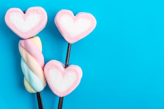 Valentines candy hearts over blue background