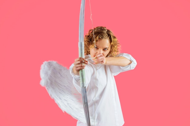 Valentines day, angel girl with arrows and bow, cupid woman with white wings.