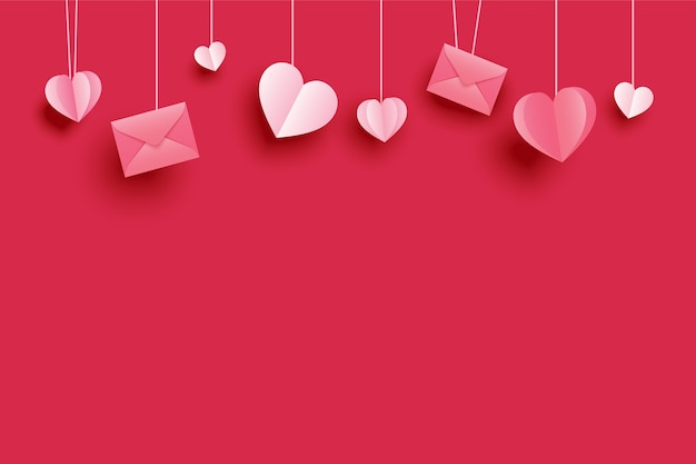 赤いパステルカラーに掛かっている紙のハートとグリーティングカードのバレンタインデーの背景。