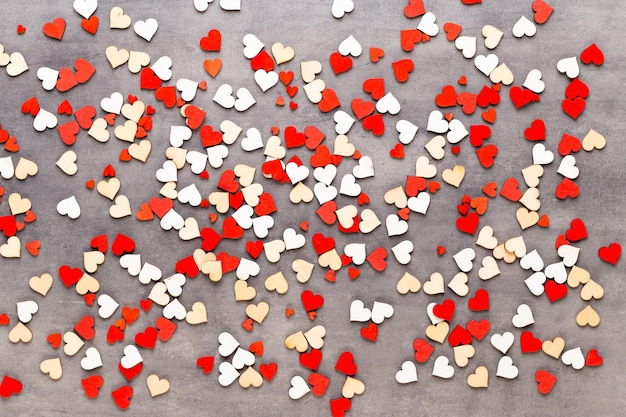 Valentines day background pastel hearts on the gray background. greeting card.