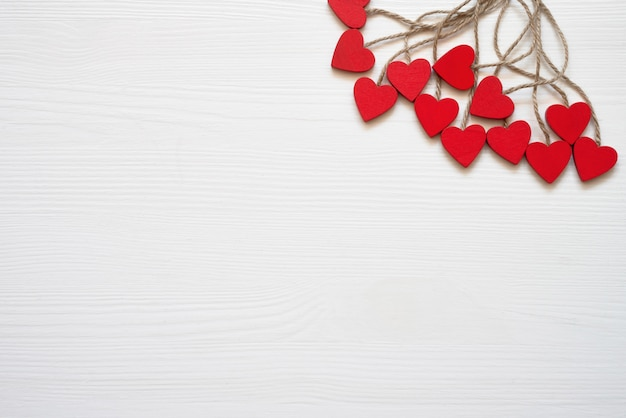 Valentines day background. red hearts decoration on white background.