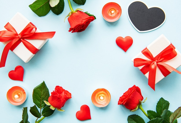 Valentines day background with gift boxes, red roses and hearts