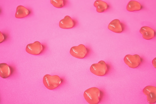 Valentines day background with heart shape candy on pink table