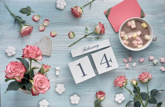 Valentines day background with pink roses, wooden calendar, greeting card and decorations..