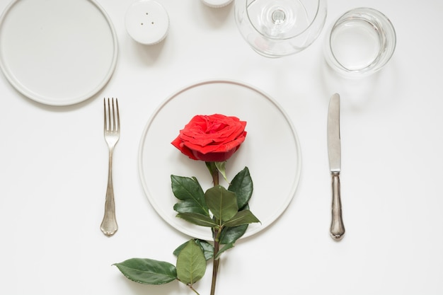 Valentines day or birthday romantic dinner. elegance table setting with red rose.