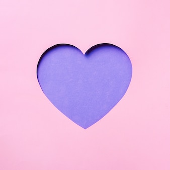 Valentines day card. cutted heart in punchy pastel paper background.