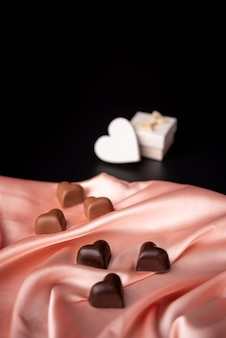 Valentines day chocolates on satin with copy space