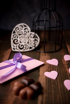Valentines day chocolates with present and hearts