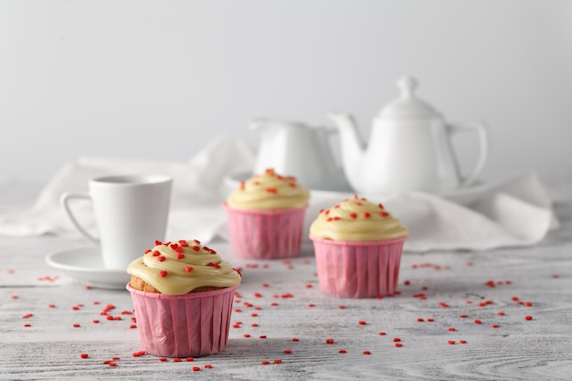 Valentines day coffee cup with cupcakes with hearts