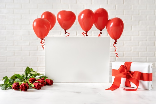 Valentines day composition with red ballons on white