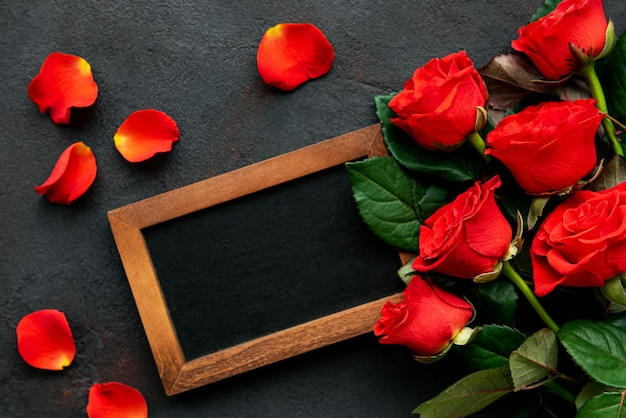 Valentines day composition with roses and chalkboard frame