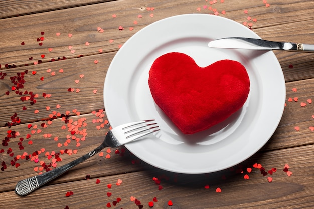 Valentines day composition on wooden table background