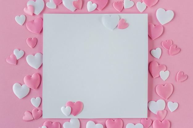Valentines day concept. greeting card with a pink and white hearts and space for text on a pink background. top view. flat lay. close up.