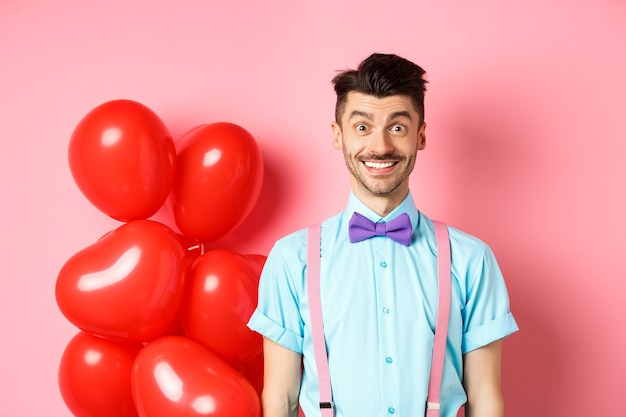 Valentines day concept. image of handsome young man looking excited and surprised