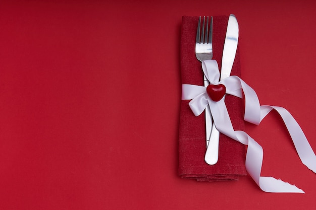 Valentines day concept. silver cutlery with heart