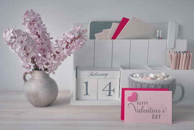 Valentines day decorations, white desk organizer with wooden cal