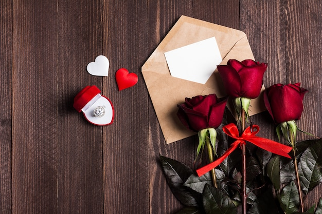 Valentines day envelope love letter with greeting card engagement ring