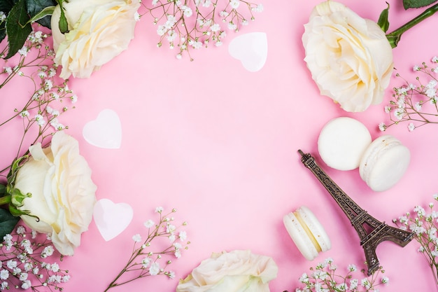 Valentines day frame with white flowers on pink