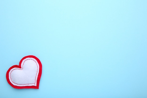 Valentines day greeting card. handmaded heart on blue background.