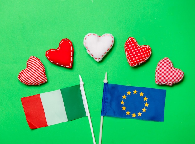 Valentines day heart shapes and flag of europe union and italy