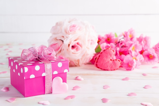Valentines day and love concept. pink gift box with heart and flowers