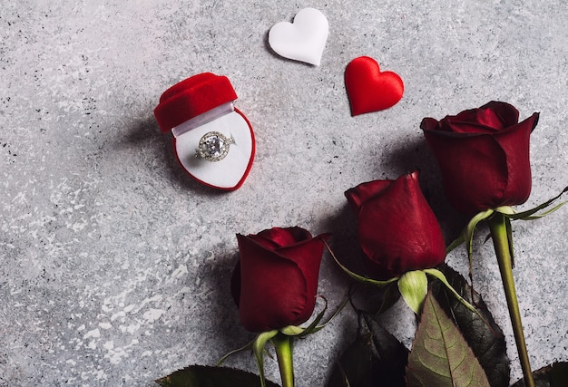 Valentines day marry me wedding engagement ring in box with red rose gift