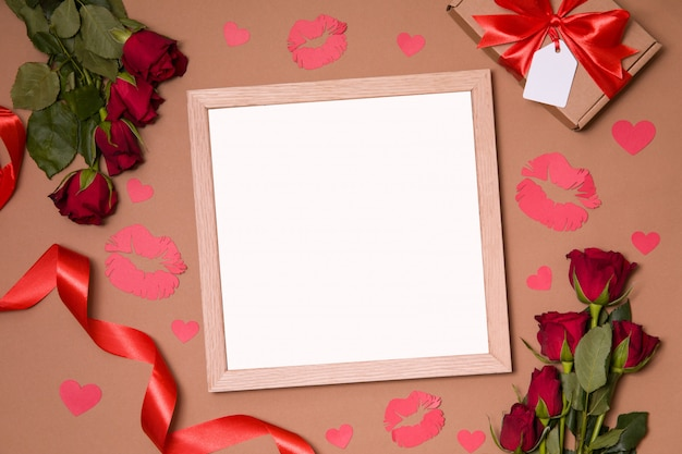 Valentines day mock up - empty clear frame on background with red roses and hearts.