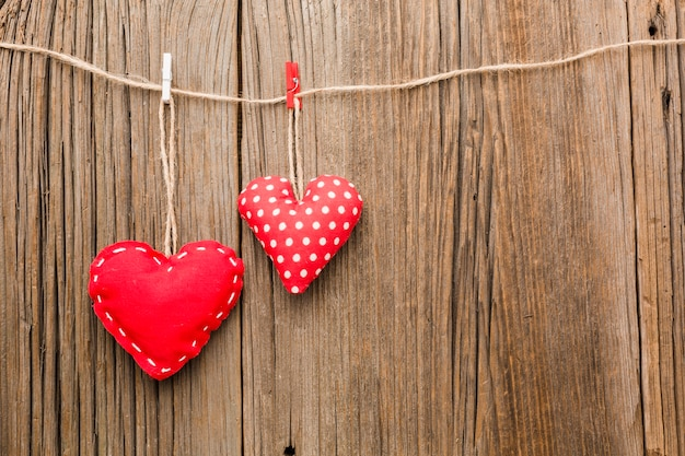 Valentines day ornaments on wooden background