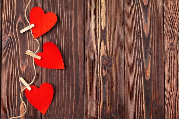 Valentines day red heart on old wood. holidays background.