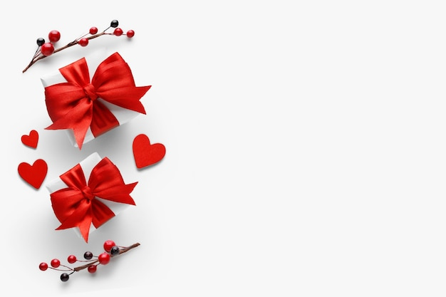 Valentines day romantic background - gifts with red bows and hearts. flat lay, top view, copy space