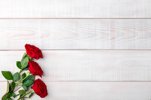 Valentines day romantic red fresh roses with green leaves