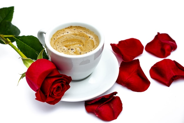 Valentines day rose with petals and coffee