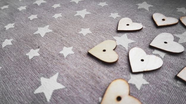 Valentines day. vintage style. hearts on old grey surface with white stars