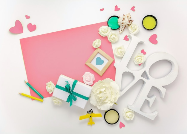 Valentines day, wedding, engagement flat lay, top view. present gift box, ribbon, hearts, rose flowers, love, pink paper