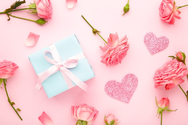 Valentines day with pink roses and gift box on mint