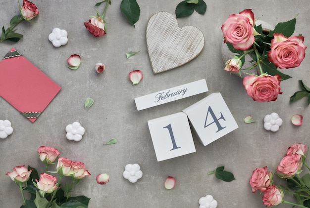 Valentines day with pink roses and wooden calendar