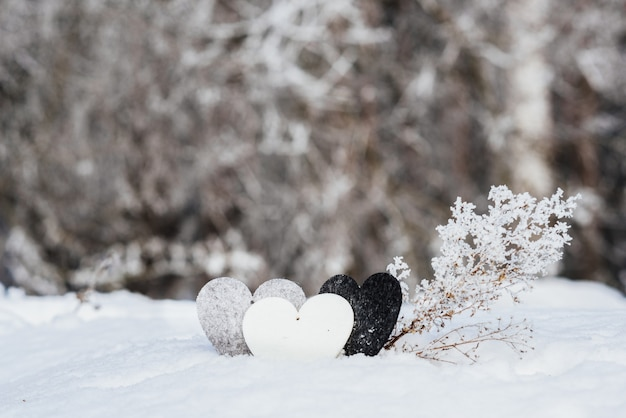 Valentines hearts on winter snow background. valentines day concept.
