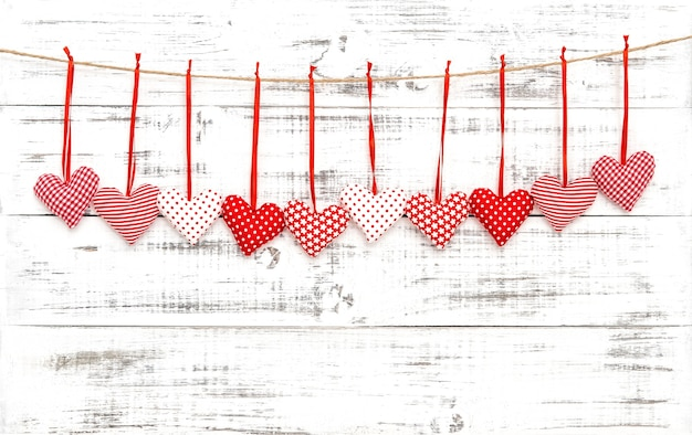 Valentines red hearts decoration on bright wooden background