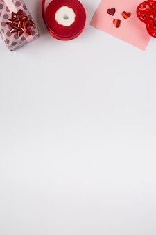 Valentines vertical background, flat lay with pink gifts and red ribbons. birthday, mothers day, valentines day photo with copy space on white, vertical, social media format, top border.