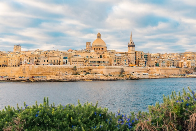 Valletta, malta old town skyline from sliema city on the other side of harbor