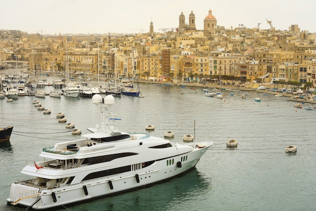The valletta port is a popular tourist attraction full of cafes and restaurants.