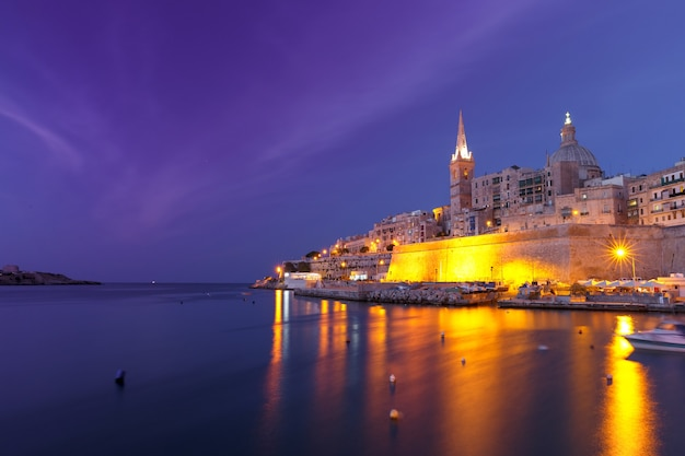 Valletta skyline at night with church of our lady of mount carmel and st. paul's anglican pro-cathedral, valletta, capital city of malta