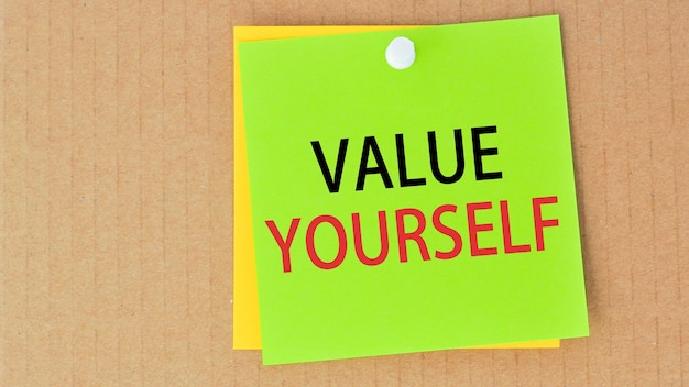 Value yourself written on green paper and pinned on corkboard