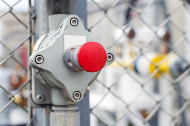 The valve in the form of a red button with an arrow.
